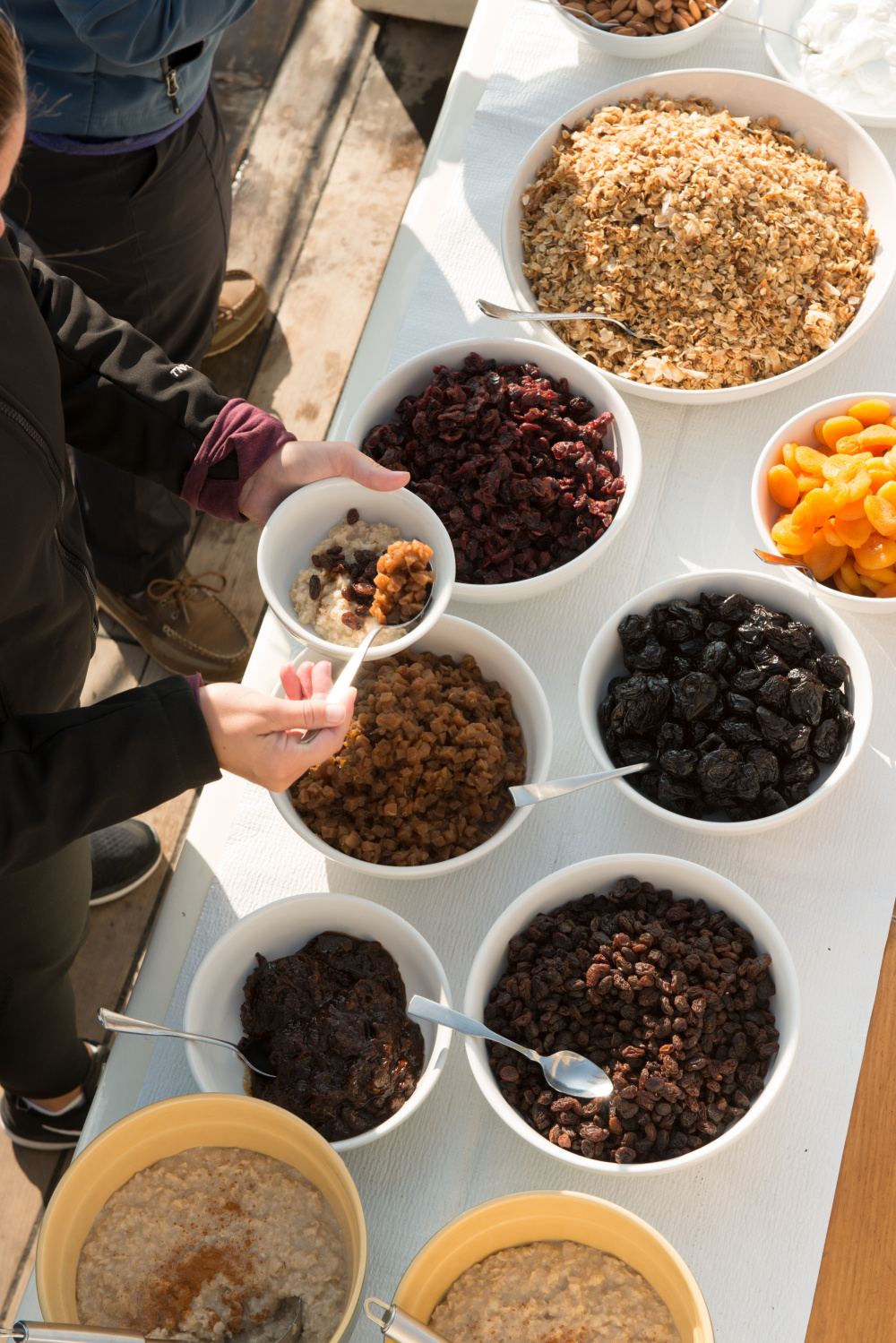 Oatmeal, hand made granola, yogurt, dried fruit, almonds, cottage cheese Photo by Douglas Merriam