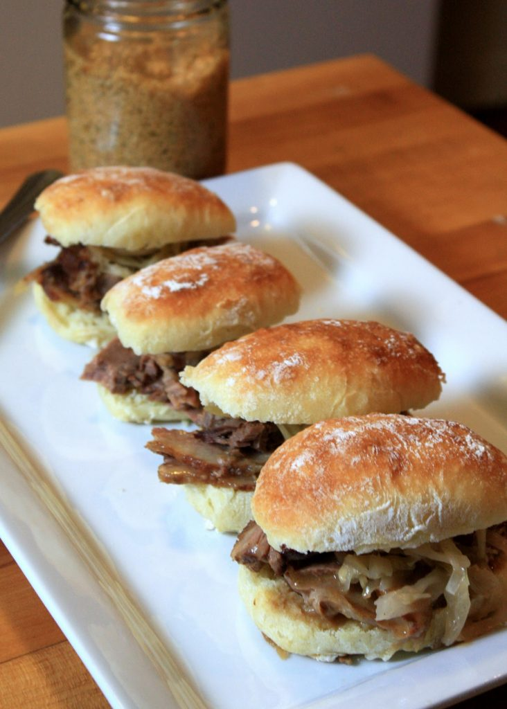 Hard Cider-Braised Brisket with Housemade Mustard and Sauerkraut on a Slider Roll Photo by Elizabeth Poisson